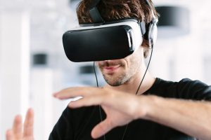 man-using-virtual-reality-simulator-headset